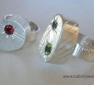 Hand engraved sterling silver, garnet, peridot rings.