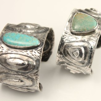 Sterling silver and tuquoise repousse' cuff bracelets.