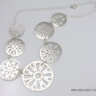 """""""Rose Windows"""", sterling silver necklace."""